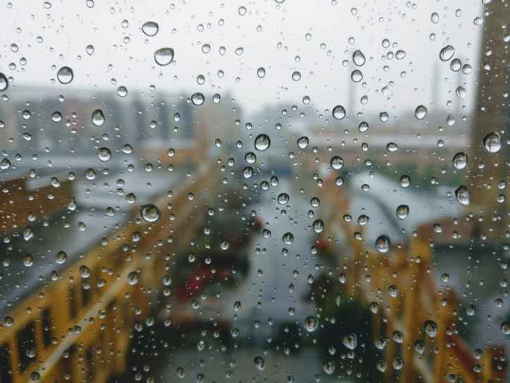 out city window with rain